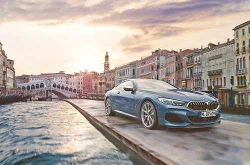 BMW 8 Series Coupe travels through Venice