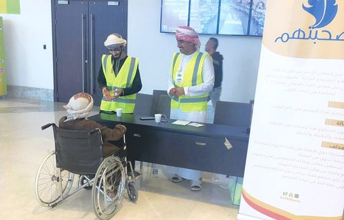 Team of volunteers assists people with disabilities at Muscat book fair